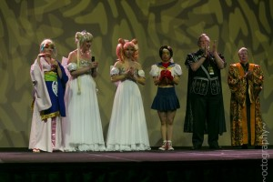 Cosplayers receiving awards at the Anime USA 2013 Cosplay Masquerade.